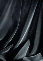 Folds in shiny black fabric