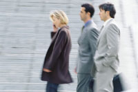 Three business executives walking