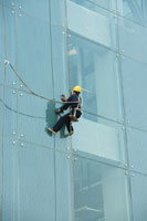 Window washer on side of office building