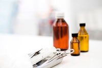 Medical tray with forceps,syringe,medicine bottles