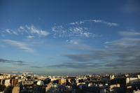 Blue sky over rooftops, Paris, France