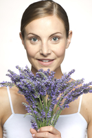 Woman holding bouquet of fresh lavender, portrait