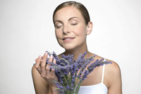 Young woman with lavender bouquet