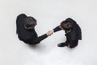 Businessmen shaking hands, overhead view