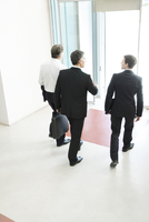 Business associates leaving office building together
