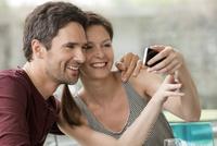 Couple posing for smartphone selfie