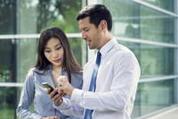 Man and woman looking at smartphone together