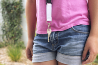 Girl wearing key around her neck, cropped