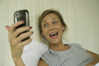 Woman smiling, taking selfie