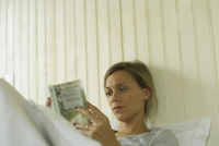 Woman reading in bed