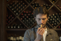 Sommelier sniffing wine cork
