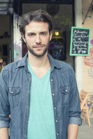 Man standing outside of cafe, portrait