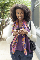 Woman using cell phone, portrait