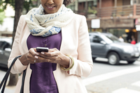 Woman text messaging on street