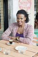 Woman sitting at sidewalk cafe