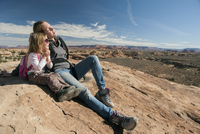 Mother and daughter resting on rock in Canyonlands National Park, Utah, USA