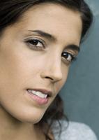 Woman glancing sideways at camera, close-up