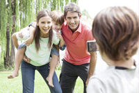 Boy taking snapshot of his family