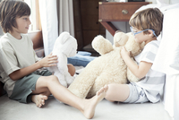 Boys playing with stuffed toys