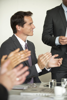 Businessman applauding at meeting