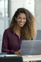 Woman using laptop computer in office
