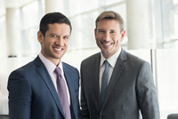 Businessmen smiling, portrait