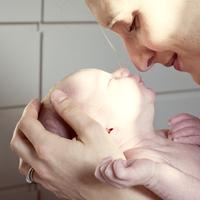 Mother bonding with newborn baby