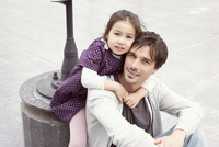 Father and daughter together outdoors, portrait