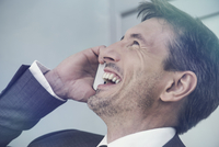 Man laughing on cell phone