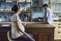 Couple together at home in kitchen