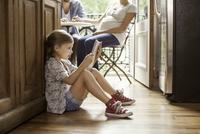 Girl engrossed in video streaming on digital tablet