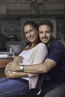 Pregnant couple, portrait