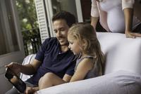 Family using digital tablet together