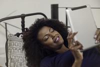 Woman enjoying book displayed on e-reader