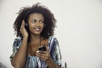 Woman listening to music playing on mp3 player