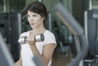 Woman lifting weights in gym