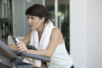 Woman working out on fitness machine
