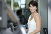 Woman smiling in fitness club, portrait