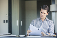 Man reading document in office