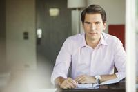 Businessman in office, portrait