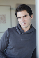 Man leaning against wall, portrait