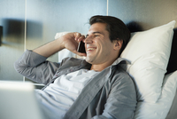 Man talking on cell phone, smiling cheerfully