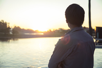 Man looking at sunset, rear view