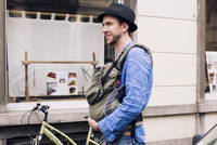 Man out and about in the city with baby in carrier