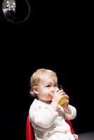 Toddler drinking juice