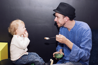 Father feeding toddler