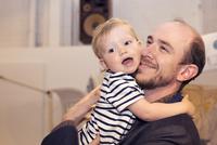 Toddler hugging father