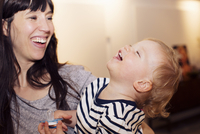 Mother and toddler sharing laugh