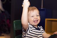 Toddler bursting out laughing