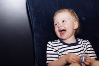 Toddler laughing, portrait